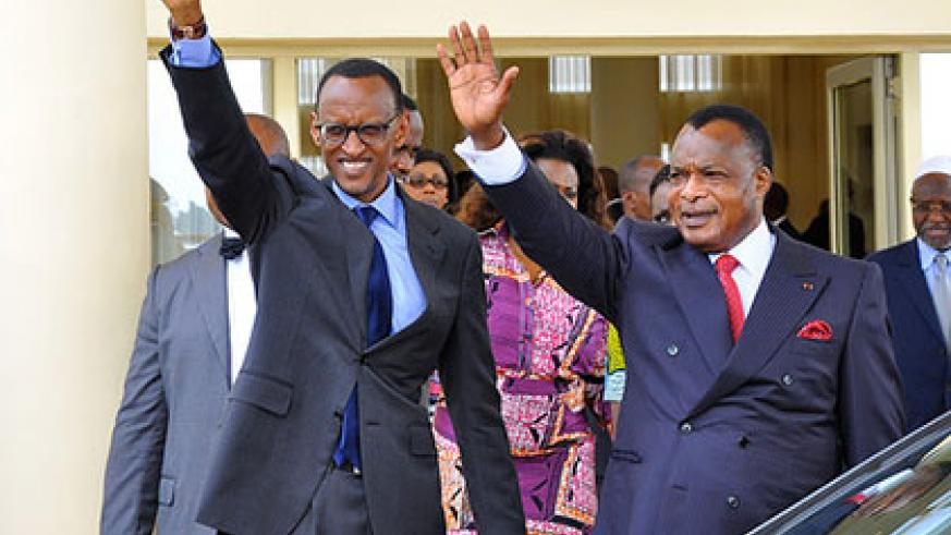 President Kagame and President Sassou N'Guesso greet the crowd at Ollombo Airport in Oyo.  The New Times/Village Urugwiro.