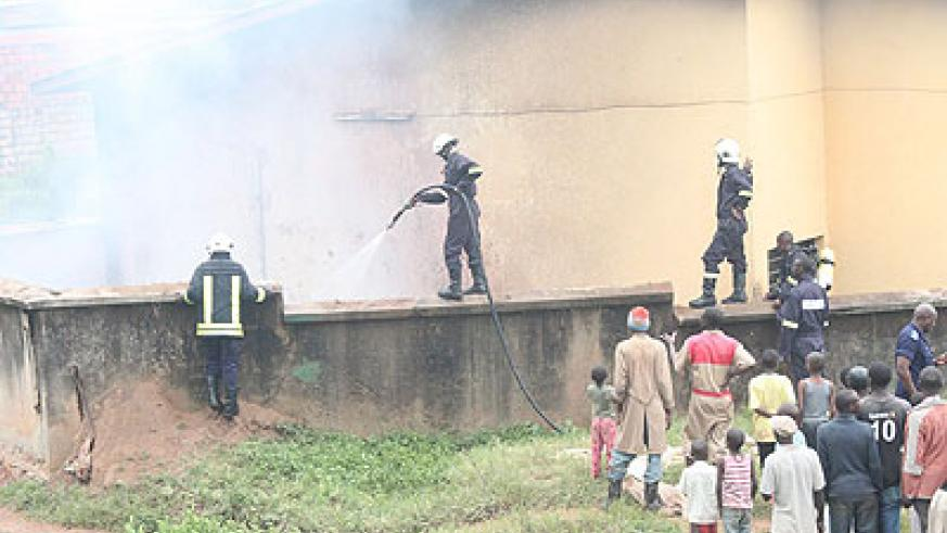Police fire brigade extinguishing at a factory in Kigali recently. The insurance sector has expanded to take on such incidents. The New Times / Plaisir Muzogeye
