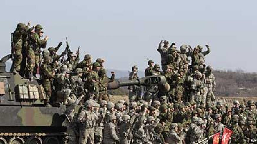 South Korean and U.S. army, gray, soldiers cheer after a live fire drill during the annual Foal Eagle maneuvers near Rodriguez Range in Pocheon, south of the demilitarised zone that di....