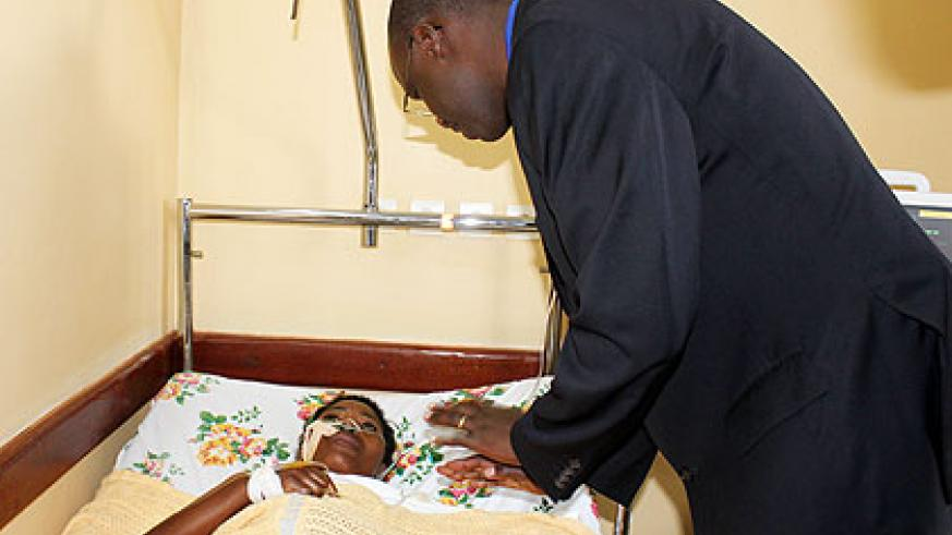 Dr Kayumba checks out a patient at the hospital shortly after inaugurating the emergency wing. The New Times/ Jean P. Bucyensenge.