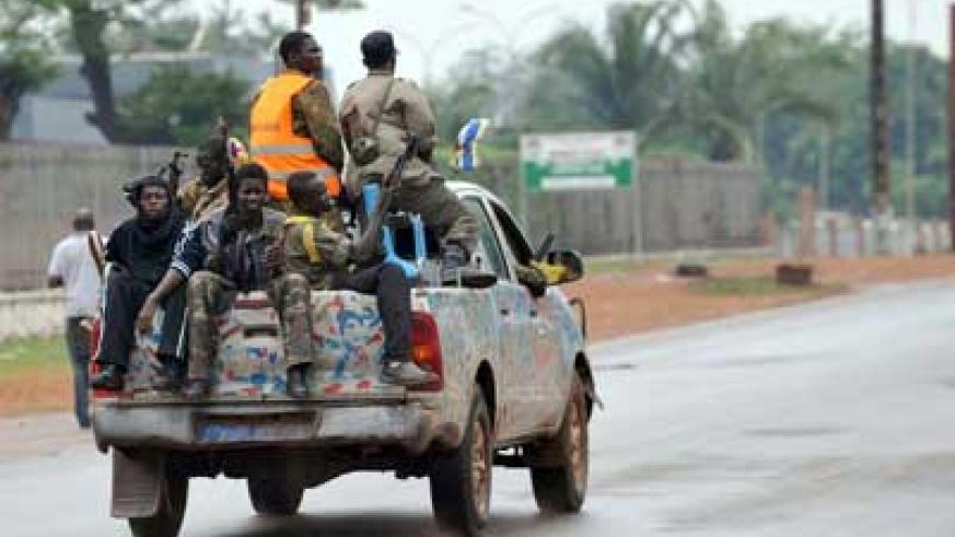 Seleka coalition rebels patrol the streets of Bangui in the Central Africa Republic on March 25, 2013. Net photo.
