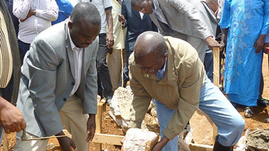 Minister Murekezi (R) and mayor Rwagaju lay a foundation stone to begin construction of the centre. The New Times/ Courtsey Photo.
