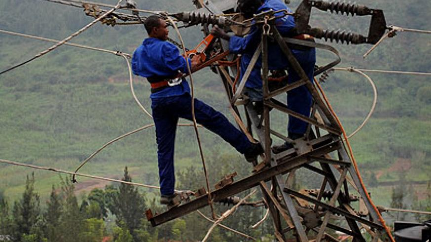 EWSA workers fixing electricity lines in the city recently. The New Times/ File
