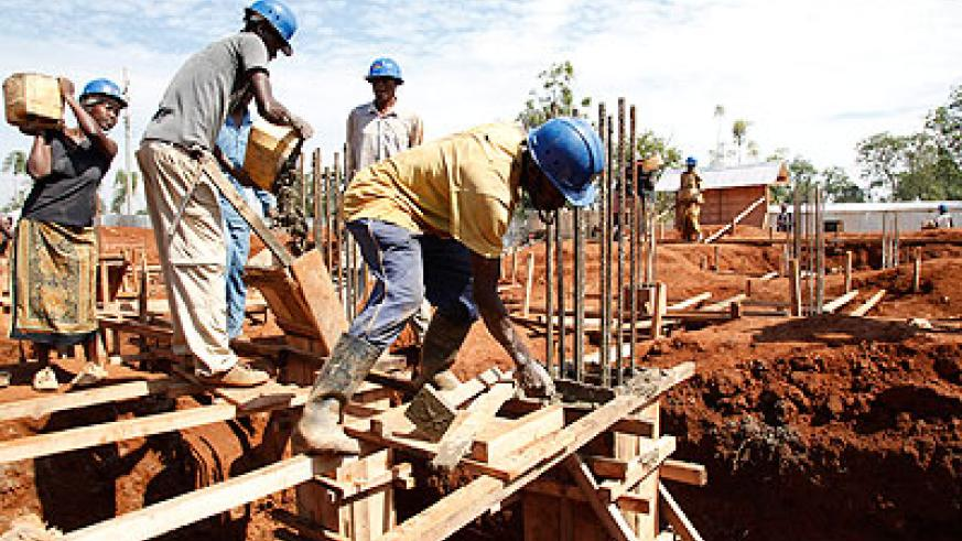 Masons work at a construction site recently. The City of Kigali has changed procedures for construction permit application.    The New Times/ File.