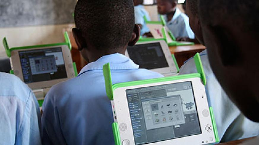 Pupils at Kagugu Primary School who have benefited from the One-Laptop-Per-Child programme; there is need to use technology to maintain our heritage.  The New Times / File.