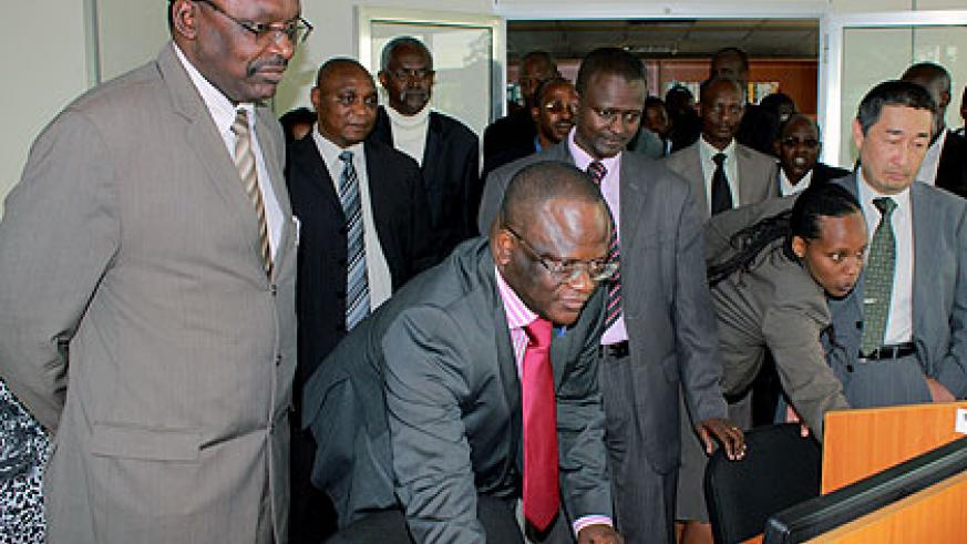 Kanimba (L) and other officials at the launch of TISC in the National Library on Tuesday. The New Times/  John Mbanda.