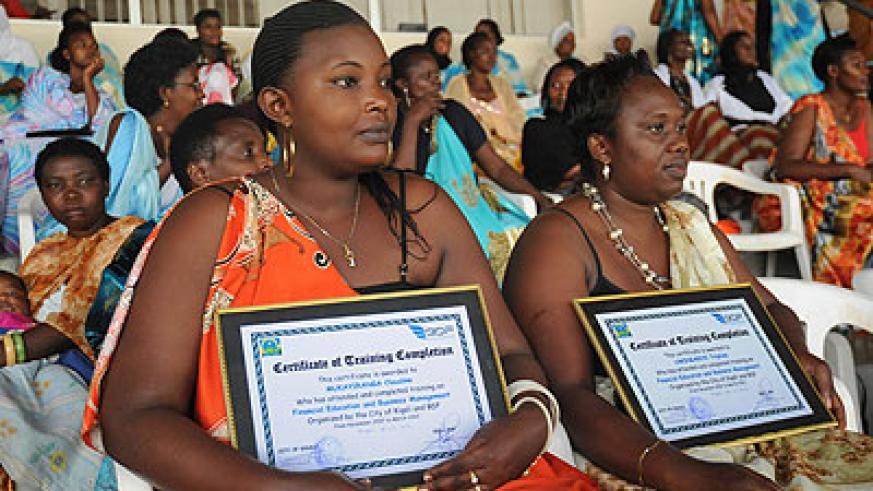 Women entrepreneurs pose with certificates they were awarded for their achievements. The New Times/  John Mbanda.