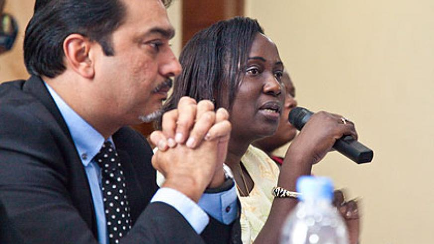 Eriyo (R) addresses the EAC participants at the launch of EAHP as Dr Thakker looks on. The New Times/ Timoty Kisambira.