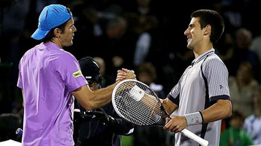 Novak Djokovic (R) congratulates Tommy Haas on his win at the Miami Masters. Net photo.