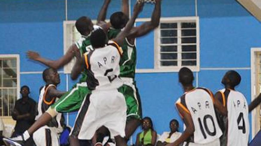Espoir (green) beat APR (white and black) in Game Three of the playoff final 78-68 at Amahoro indoor stadium to complete a 3-0 whitewash. The New Times / P. Muzogeye.