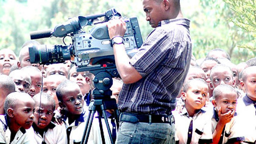 A cameraman at work. Access to Information Law is still being streamlined to appeal to the media. The New Times/  File.