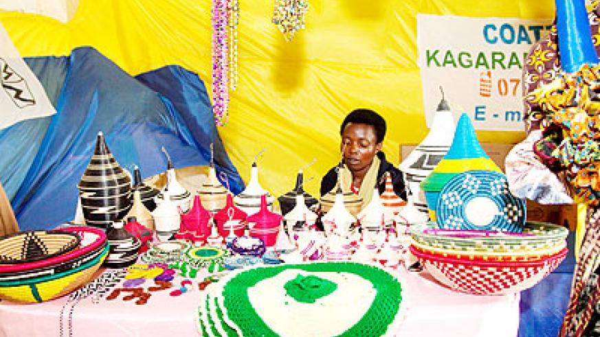 An exhibitor showcases her products at the Mini-expo in Gikondo yesterday.  The New Times/  Timothy Kisambira.