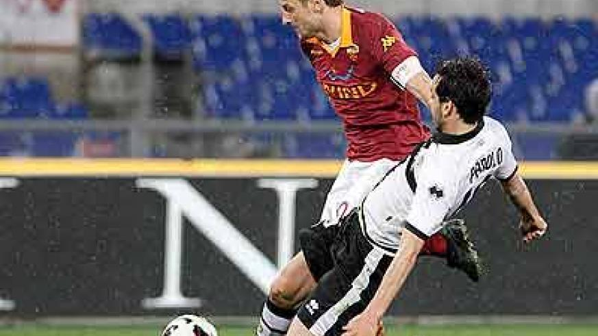 Francesco Totti is fouled by Parma midfielder Marco Parolo during a Serie A match earlier this month. Net photo.