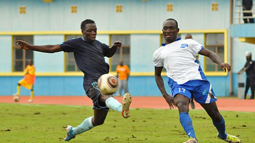 Rayon Sport's midfielder Cedric Amissi attempts a cross past Police's defender Abouba Nshimiyimana in a Primus league encounter at Amahoro stadium yesterday.  The New Times / Plais....