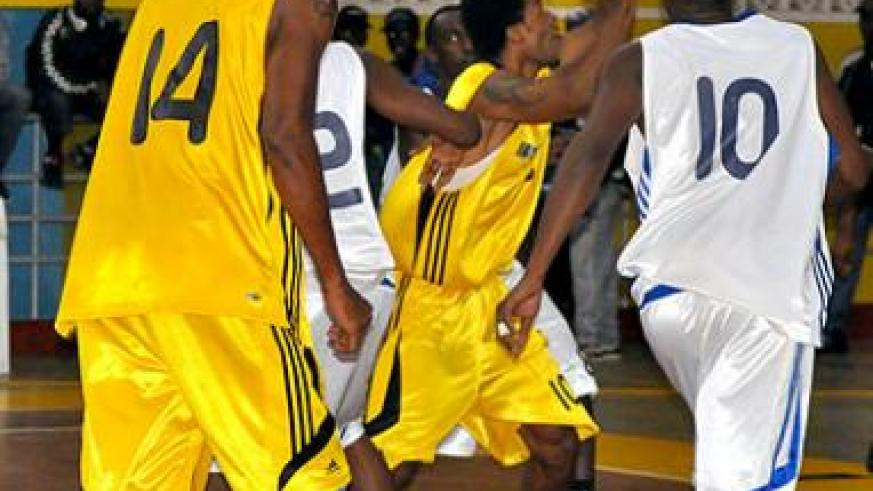Mike Bazangu (with the ball) and Kami Kabange (shirt 14) are the two most experinced players on the team for this year's Afro-basket championship. The New Times / P. Muzogeye.