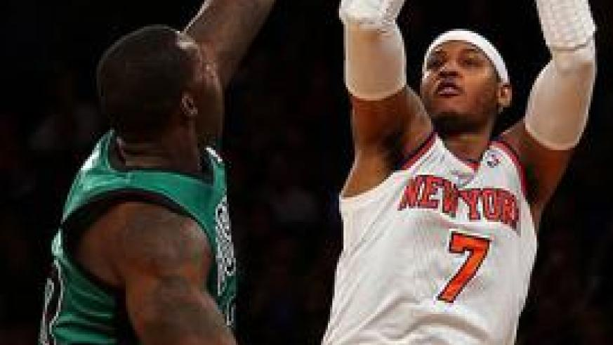 Carmelo Anthony #7 of the New York Knicks takes a shot as Jeff Green #8 of the Boston Celtics defends. Net photo.