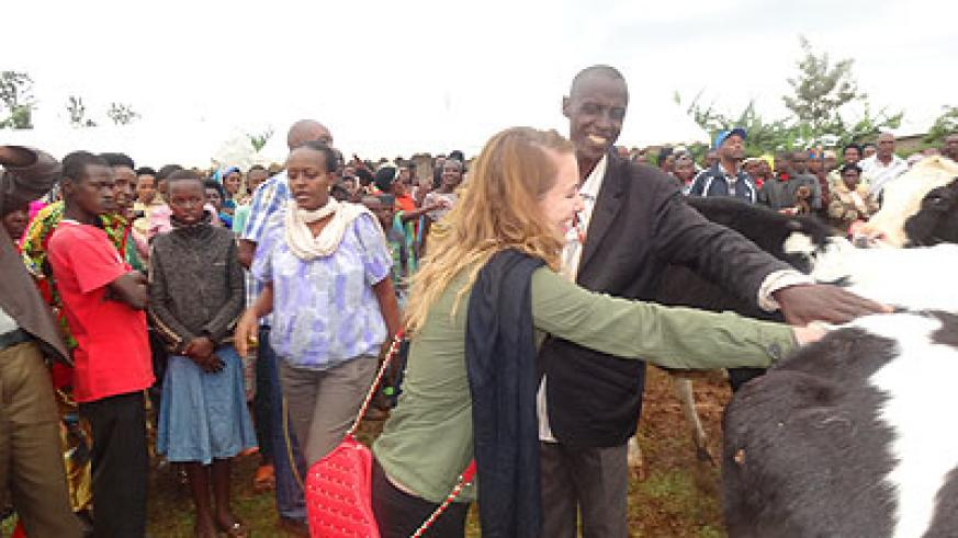 A MSAAD project official gives out a cow. The Girinka project aims at boosting milk production in the country. The New Times / Peterson Tumwebaze.