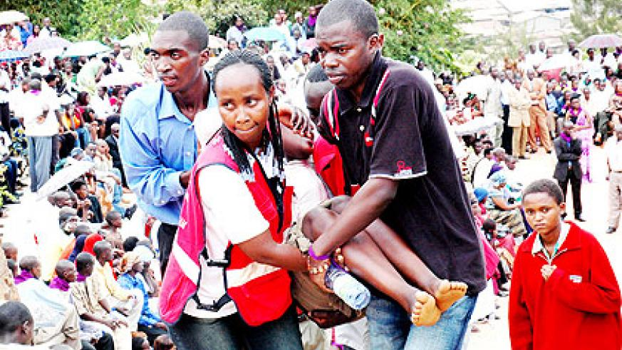Red Cross volunteers evacuate a child who had collapsed during a past commemoration in Kigali.   The New Times/ John Mbanda.