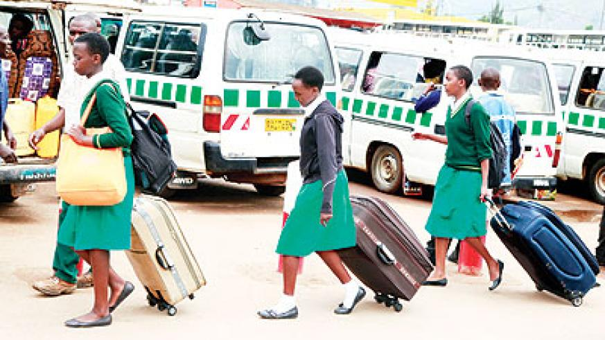 Students returning from school for holidays. Education Times/ Timothy Kisambira