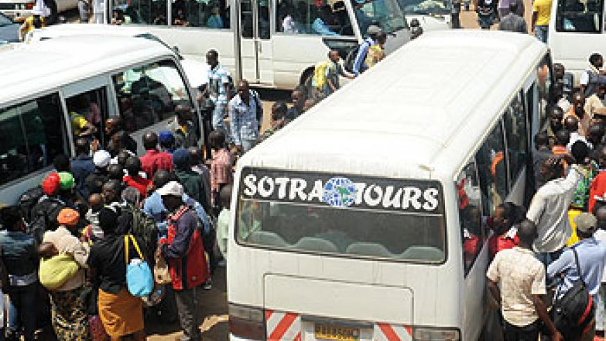 Travellers line up to board a bus. The transport sector is one of those identified by the Rwanda Development Board as requiring more investment. The New Times/File