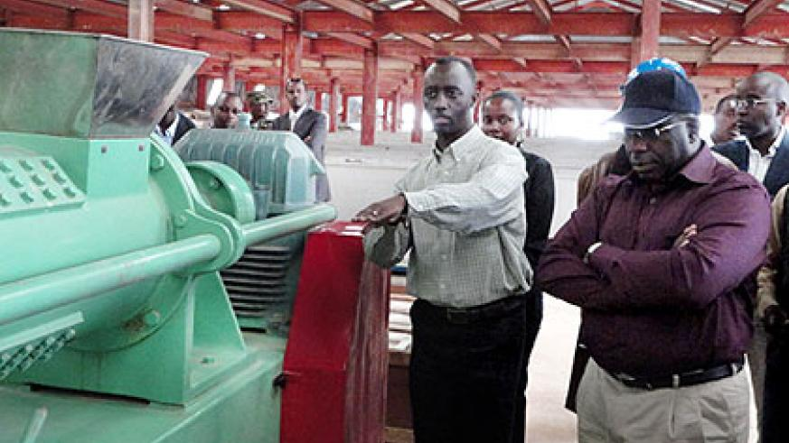 Prime Minister Pierre Damien Habumuremyi (R) is shown around a tea factory in Nyamagabe owned by Multi-sectoral Investment Group in January. The New Times/File.