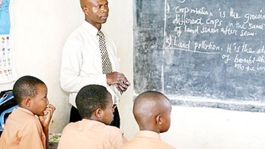 A teacher conducts an English lesson. Similar efforts should be put into teaching Kiswahili across the country. The New Times/File.