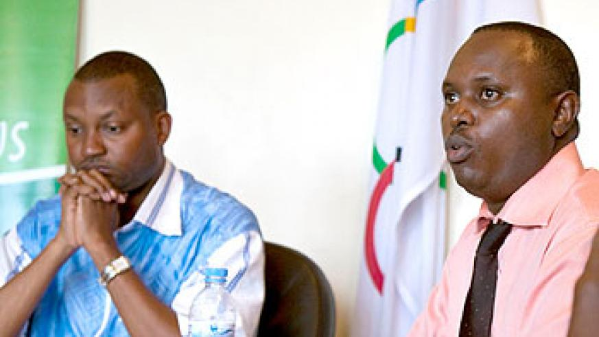 Rwanda Olympic Committee Secretary General Parfait Busabizwa (L) and Philbert Rutagengwa (R), head of the election commission in a news conference held yesterday at the committee's h....