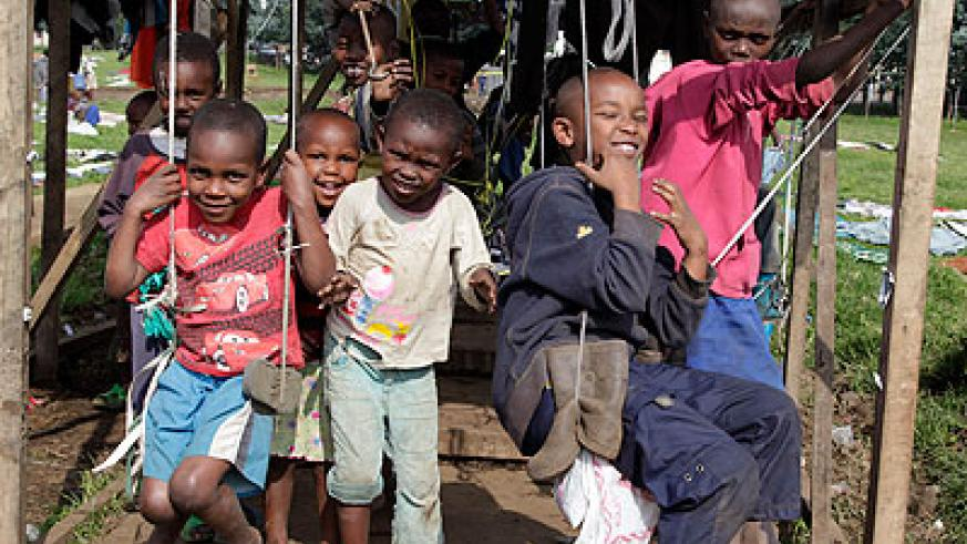 Children play in Nkamira transit camp. The New Times/ Timothy Kisambira.