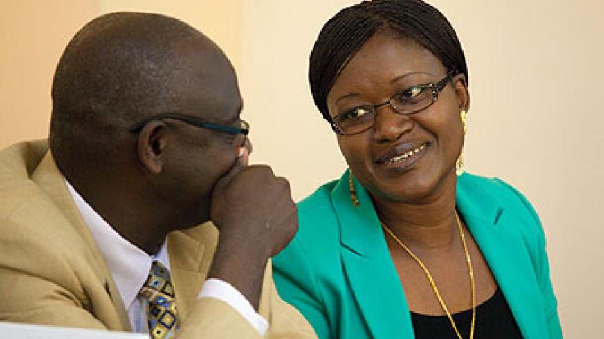 Minister Mukaruliza (R) chats with Businge during the workshop. The New Times/ Timothy Kisambira.