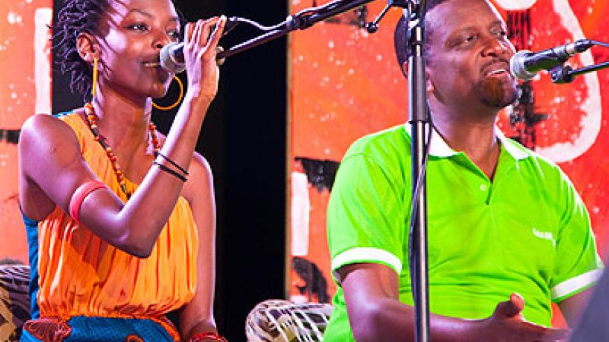 The founder of Gakondo group, Intore Massamba (R) performs with Diana Teta in a tribute concert to remember the country's fallen musician, Athanase Sentore.