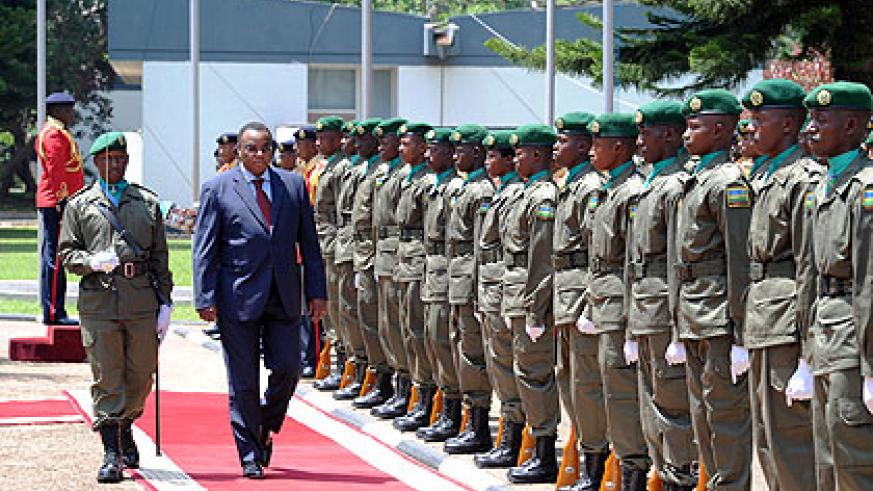 Mwangemi inspects a guard of honour before presenting his credentials to President Kagame yesterday. The New Times/ Village Urugwiro.