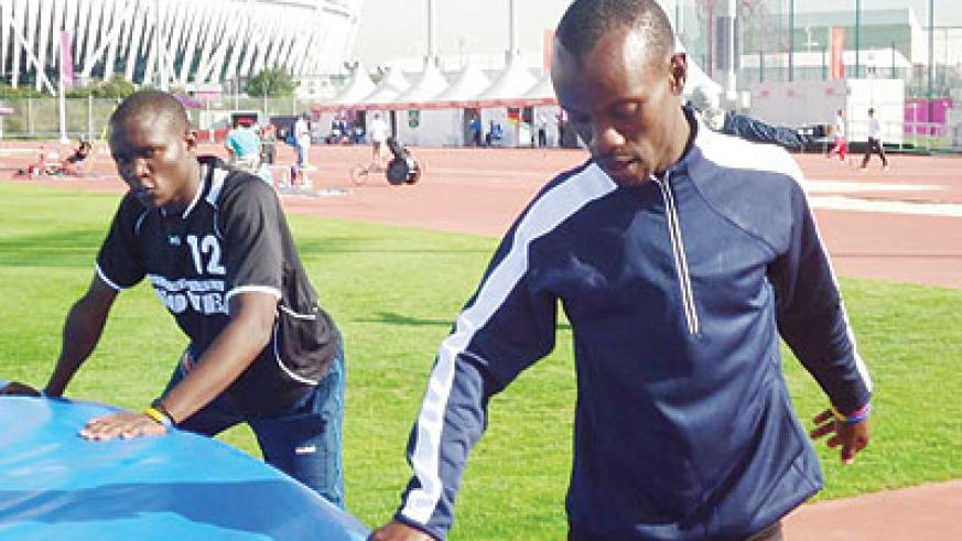 NPC athletes Hermans Muvunyi (right) and  Théoneste Nsengimana in training during the 2012 Paralympic Games in London. Saturday Sport/Pascal Bakomere.
