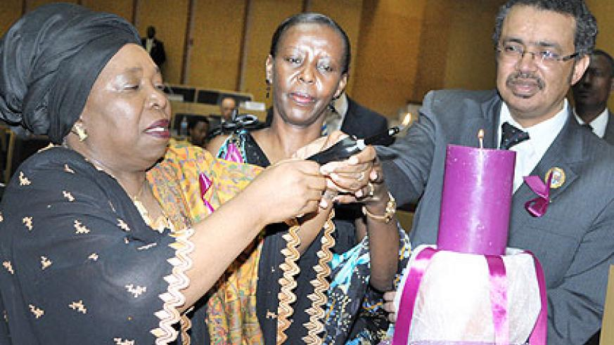 L-R: Dr Zuma, Mushikiwabo and Adhanom light a memorial candle in Addis Ababa. Courtesy