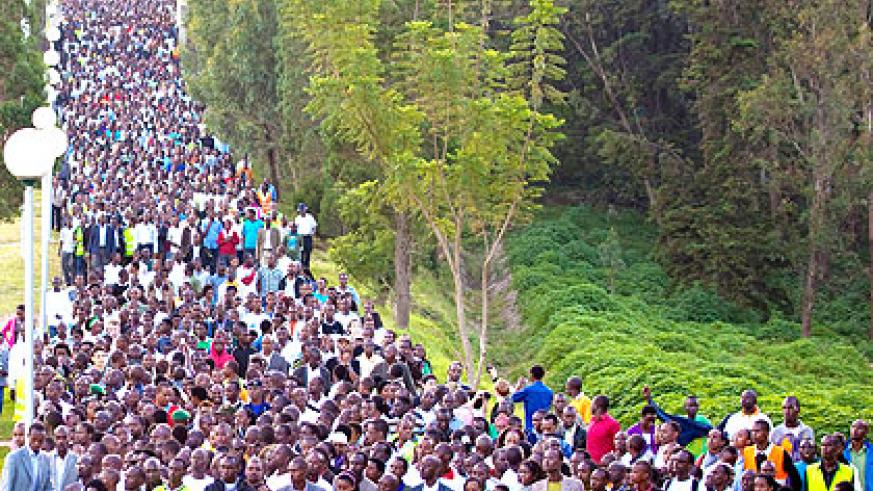 Multitudes of Rwandans who turned up for the Walk To Remember await to start outside the Parliamentary Buildings yesterday. The New Times/  Village Urugwiro.
