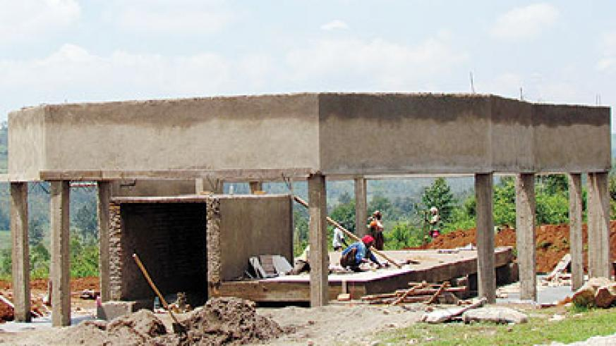 Masons work at a Genocide memorial centre in Kabakobwa. Thousands of fleeing Tutsis from Ngoma commune and the surrounding districts took refuge in a church on the hill, only for the m....