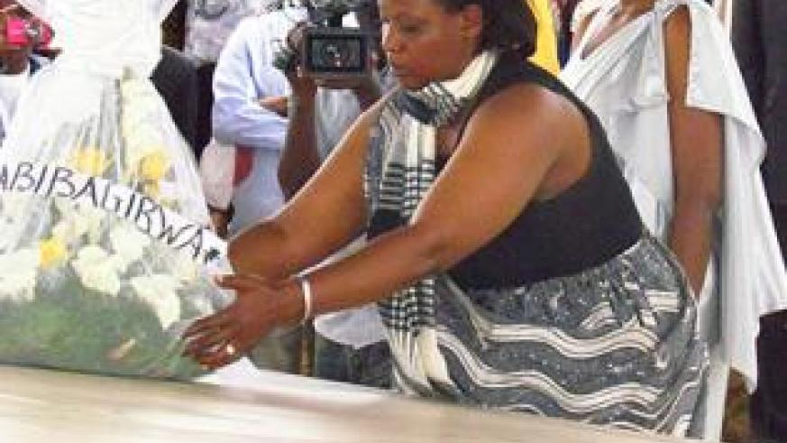 Southern Province Executive Secretary Jeanne Izabiriza lays a wreath in honour of Genocide victims yesterday. The New Times/JP Bucyensenge