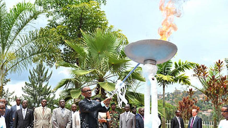 President Kagame lights the  The Flame of Hope at the Kigali Genocide Memorial Centre. (Photos by Village Urugwiro  & T. Kisambira.)