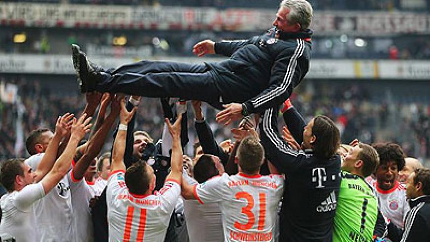 Head coach Jupp Heynckes is thrown into the air in celebration. Net photo.
