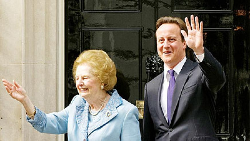 Baroness Thatcher (L) and UK premier Cameron wave to the crowd at 10 Downing Street. Net photo.