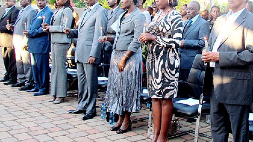 Rwandans in South Africa together with their friends and well-wishes observe a moment of silence in memory of the victims of the 1994 Genocide against the Tutsi.  The New Times/ Courtesy.