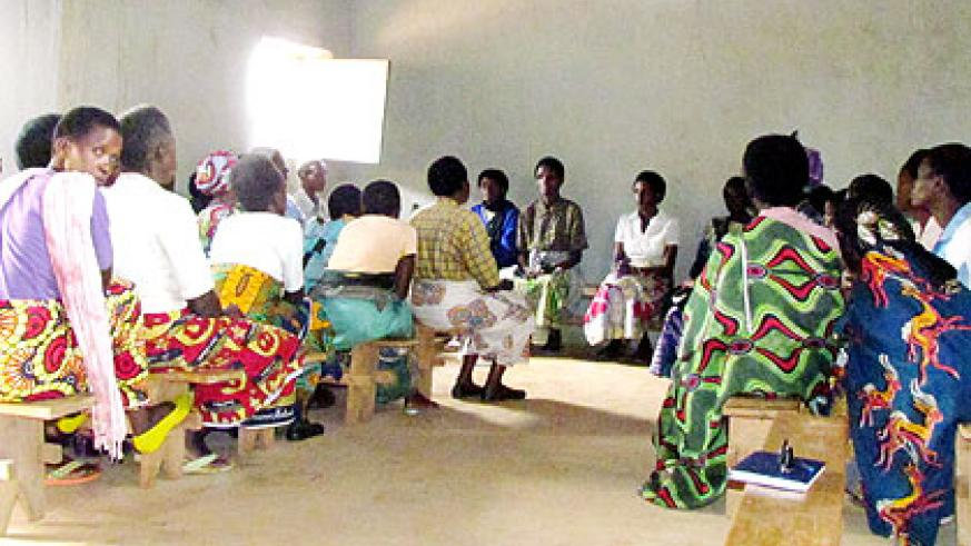 Members of the Ubutwari bwo Kubaho during their meeting. Inset is the association's poultry. The New Times/ Jean P. Bucyensenge.
