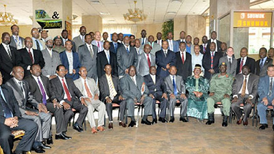 Participants of the 9th Extra Ordinary meeting of the Council of Ministers of Defence and Security of the Eastern Africa region pose for a group photo after a session. The New Times/G.....