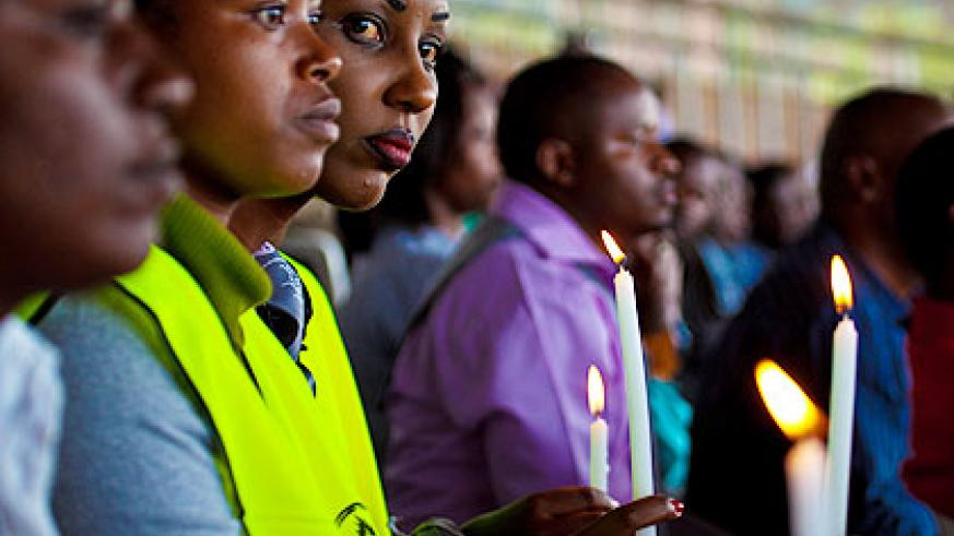 Mourners from Nyarugenge district observe the candle night ceremony in honour of the victims of the 1994 Genocide against the Tutsi. The New Times/ T. Kisambira.