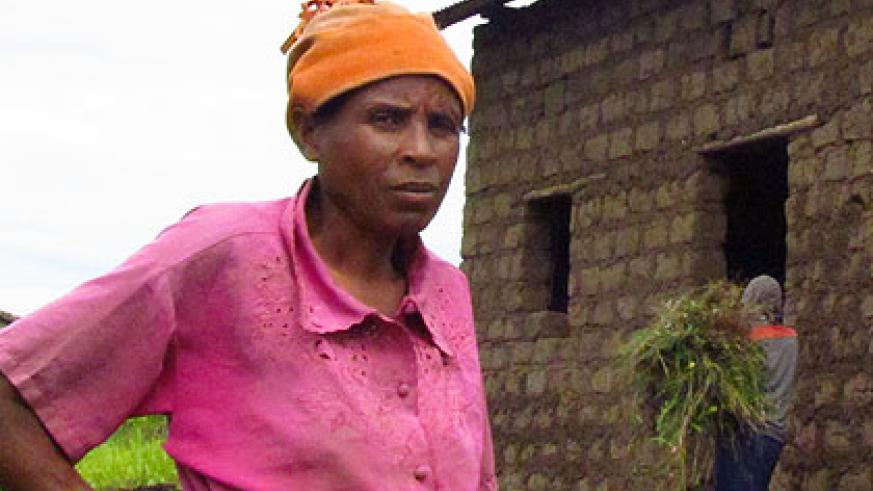 Mukankundiye in front of a house being built for her in Buhoro cell. The New Times/Jean Pierre Bucyensenge.