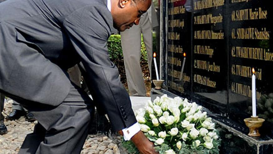 Minister Biruta lays a wreath at the newly-unveiled monument erected in memory of staff who died during the Genocide against the Tutsi. The New Times/Timothy Kisambira.