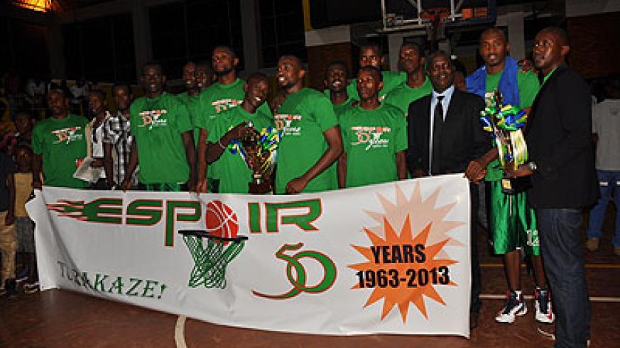 Espoir players and officials after winning the playoffs final trophy last month. The club is favourite to win the Gisembe memorial tournament in June. The New Times/P. Muzogeye.
