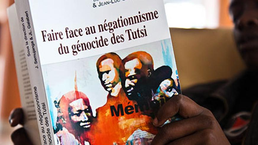 A man reads the newly-published book on Genocide denial yesterday. Rwandans have been urged to document the Genocide in order to fight denial. Saturday Times/ T. Kisambira.
