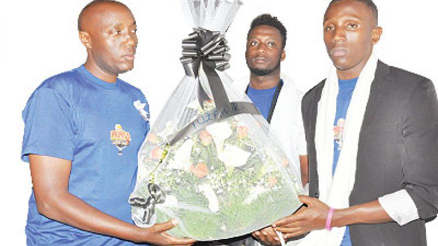 Primus Guma Guma SuperStar contestants lay a wreath at the Rwakibuza memorial site during a ceremony on Friday in Kamonyi.