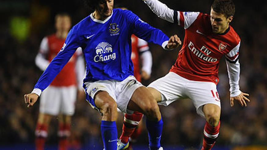 Everton's Marouane Fellaini  competes with Aaron Ramsey of Arsenal during the corresponding fixture at Goodison Park in November which ended 1-1. Net photo.