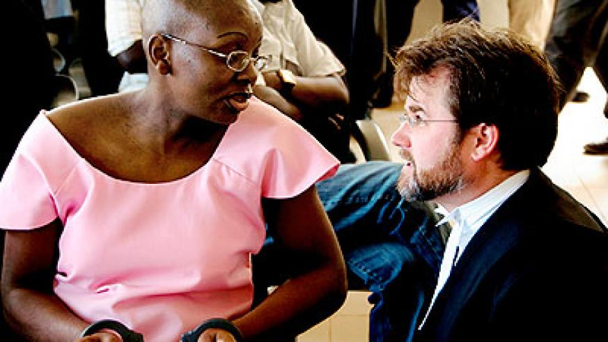 Ingabire (L) consults with her lawyer Edwards during her trial. She is challenging her sentence today. The New Times/ File.